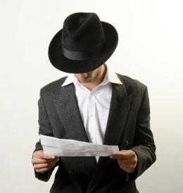 Man Wearing Hat Reading Paper